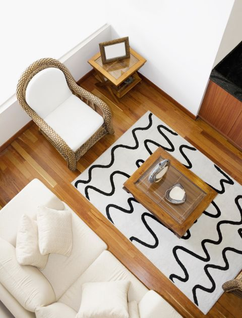 Living room rugs must neither be too big nor too small for the space